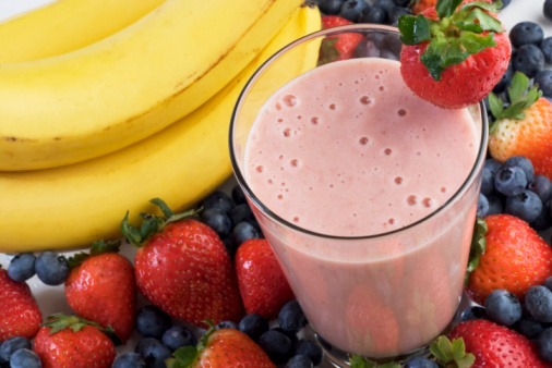 Smoothie surrounded by fruits